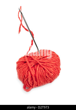 Red thread ball and needle with pink thread isolated on white - Stock Photo
