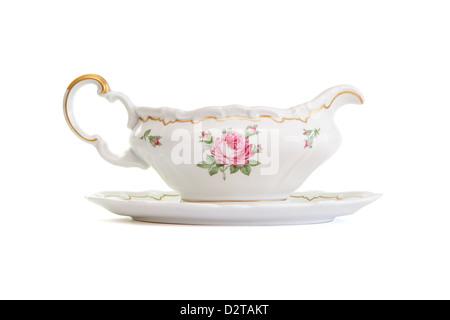 Vintage porcelain sauce-boat isolated on white background - Stock Photo