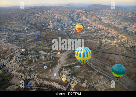 Aerial view of Rose and Red Valleys Goreme first light on Uchisar and Goreme National Park from a hot air balloon - Stock Photo