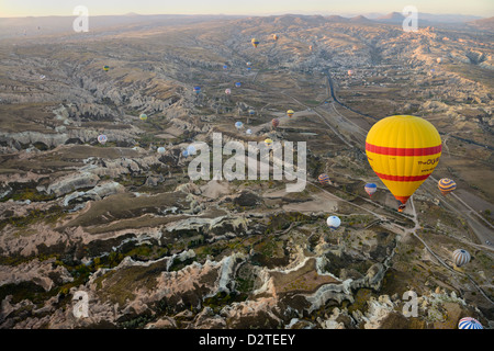 Aerial view of Zelve Valley with Rose and Red Valleys Goreme and Uchisar at first light from a hot air balloon Cappadocia - Stock Photo