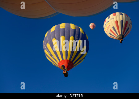 View of overhead hot air balloons and flame from propane heater in Cappadocia Turkey - Stock Photo