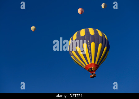 Overhead hot air balloons and flame from propane heater in Cappadocia Goreme National Park Nevsehir Turkey - Stock Photo