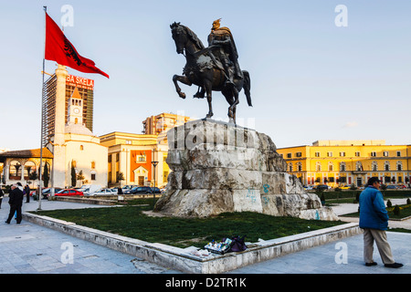 Skanderbeg statue, Albanian flag and Ethem Bey mosque at Skanderbeg square. Tirana, Albania - Stock Photo