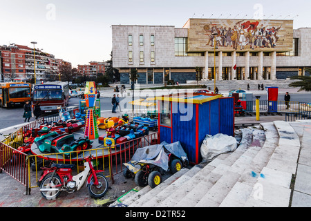 National Historical Museum with carousel in Skanderbeg square , Tirana , Albania - Stock Photo