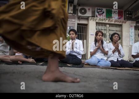 Phnom Penh, Cambodia - Mourners gather on the streets prior to the funeral procession of former Cambodian King Norodom - Stock Photo