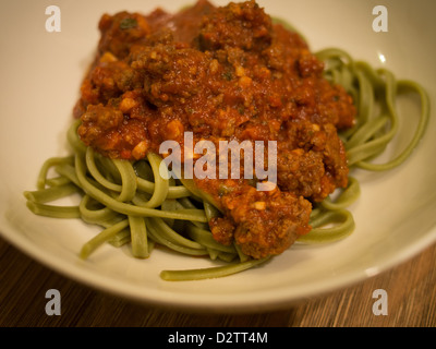 Green spinach spaghetti pasta and meat sauce - Stock Photo