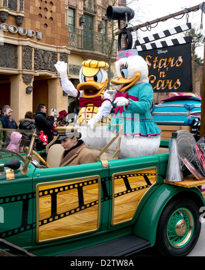 Donald Duck and Daisy Duck taking part in Disney's Stars n Cars Parade at Disneyland Paris - Stock Photo