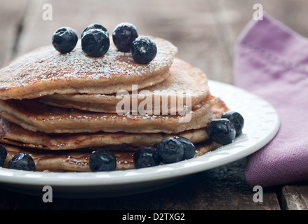 Golden stack of flapjacks with fresh blueberries - Stock Photo