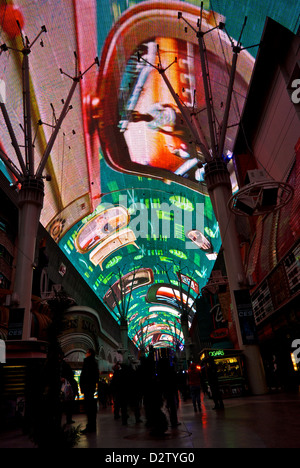Hourly sound light show world's largest overhead roof cover four block long video screen Fremont Street Experience - Stock Photo
