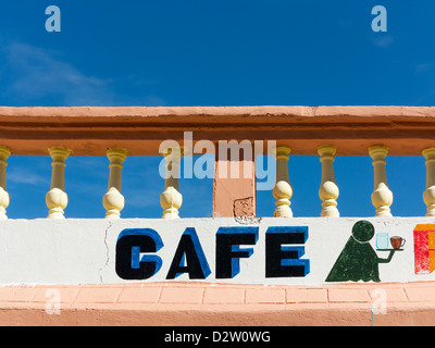 Sign set against bright blue clear sky at Cafe in the High Atlas mountains - Stock Photo