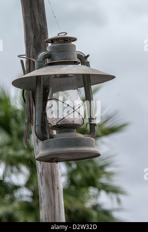 A kerosene lantern on a pole seen from a lower angle - Stock Photo