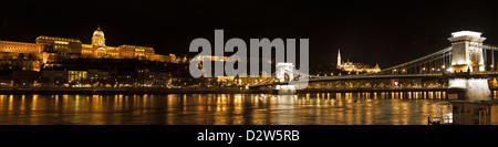 Night Panorama over the Danube featuring the chain bridge and the Buda Palota - Stock Photo