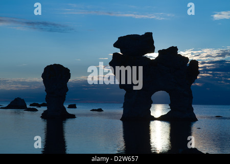 Rauks by sunset. Rauk is the lokal word for seastacks(eroded limestone formations. At Gamle Hamn, Fårö, Gotland, - Stock Photo