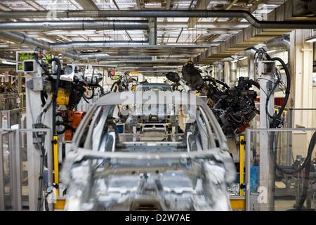 Wolfsburg, Germany, Volkswagen factory, welding robots in the body shop, welding line - Stock Photo