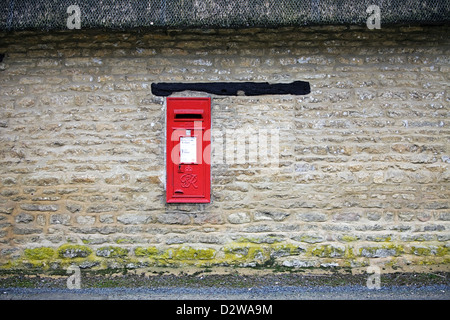 Royal Mail Post Box in a village wall, Minster Lovell Oxford - Stock Photo