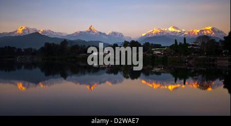 Annapurna mountain range reflecting in lake Phewa in Pokhara, Nepal. - Stock Photo
