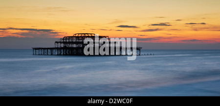Brighton's burnt out west pier at sunset in East Sussex, UK. - Stock Photo