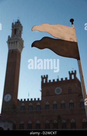 Palio start/finish line with Palazzo Publico behind. Siena, Tuscany, Italy - Stock Photo