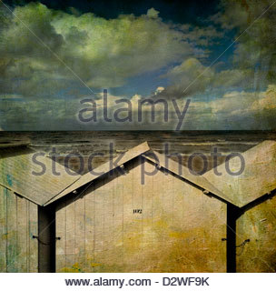 Beach huts under a stormy sky, vintage-look, Normandy, France, Europe - Stock Photo