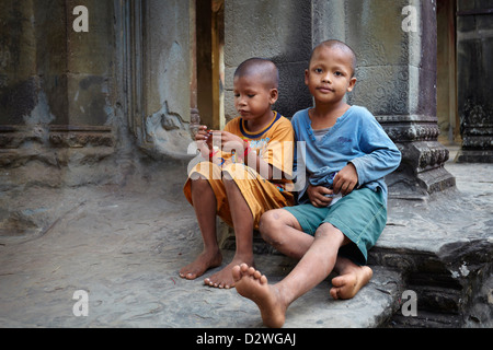 Portrait of cambodian children, Angkor Wat Temple, Cambodia - Stock Photo