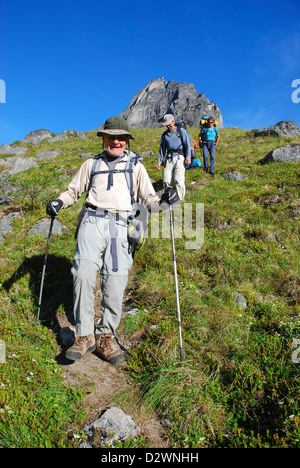 Backpackers descending on a steep trail from Cirque of the Unclimbables, in Canada's Northwest Territories. - Stock Photo