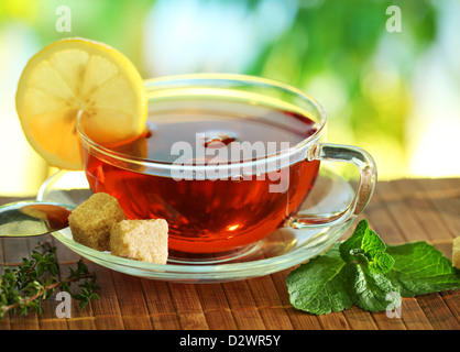 Cup of tea on a blurred background of nature. - Stock Photo