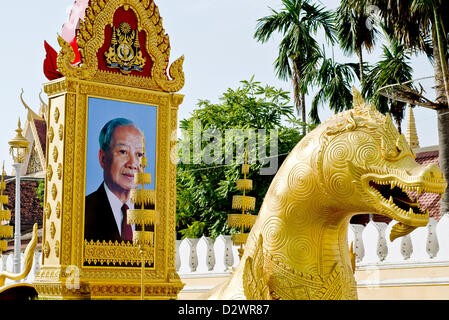 Dragon-shaped vehicle with the portrait of the late King FatherNorodom Sihanouk in front of the Royal Palace,Phnom - Stock Photo