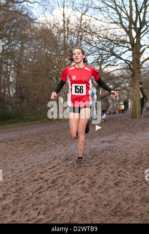 Cross Country Championships senior and inter youth girls extremely muddy conditions on a slope striding down to - Stock Photo