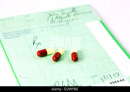 An NHS Prescription pad and drugs - the concept of prescription drugs, England UK - Stock Photo
