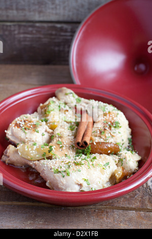 Classic Moroccan chicken tagine with caramelized pears, cinnamon and sesame - Stock Photo