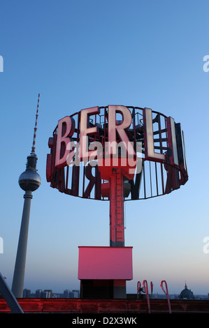 Berlin, Germany, illuminated sign with the word Berlin TV tower in the background d - Stock Photo