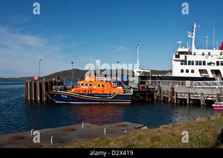 Coast Guard boat RNLB Edna Windsor and cruise liner Hebridean Princess lie at dock in Castlebay, Isle of Barra, - Stock Photo