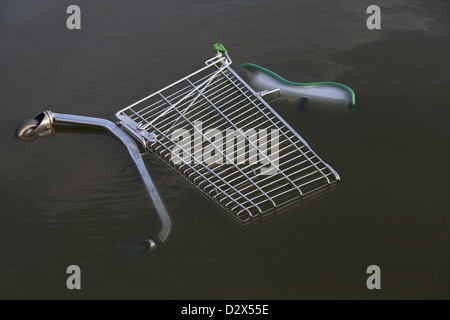 shopping trolley in water waste stock photo royalty free. Black Bedroom Furniture Sets. Home Design Ideas