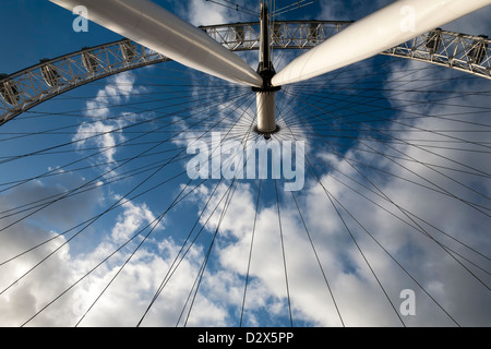 The famous London eye in detail, over a blue cloudy sky. It is one of the most visited places in the United Kingdom - Stock Photo