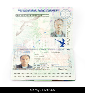 A 2013 European Union biometric passport for the United Kingdom (with fictitious details) - Stock Photo