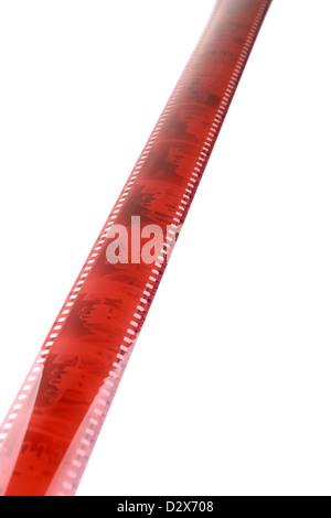 Old camera film strip diagonal over a white background - Stock Photo