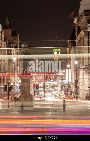 Traffic rush hour in the Trafalgar Square in London, United Kingdom, with the international landmark Big Ben, in - Stock Photo