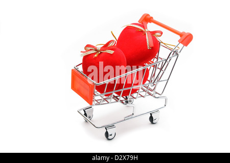 Hearts in shopping cart isolated on white background - Stock Photo