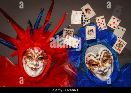 Close up of a two persons wearing a mask during the Carnival in Venice, Italy - Stock Photo