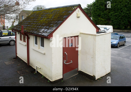 A public toilets on a village car park in cornwall, uk - Stock Photo