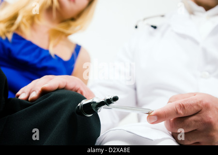 Doctor Testing reflexes - Stock Photo