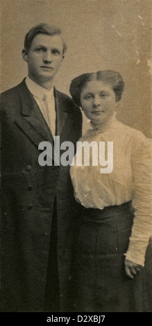 Circa 1890s photograph, Victorian husband and wife in period dress.