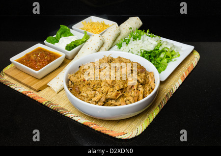Chicken tacos with lettuce onions sour cream and cheddar cheese - Stock Photo