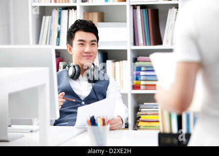 Young business colleagues in the office - Stock Photo