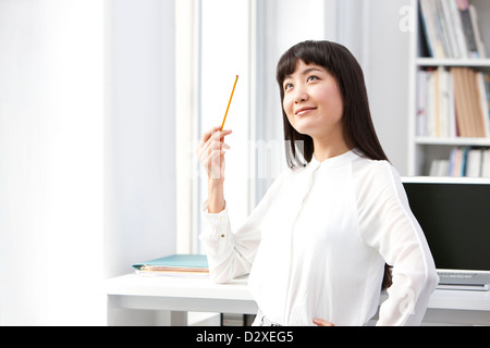 Happy young businesswoman in the office - Stock Photo
