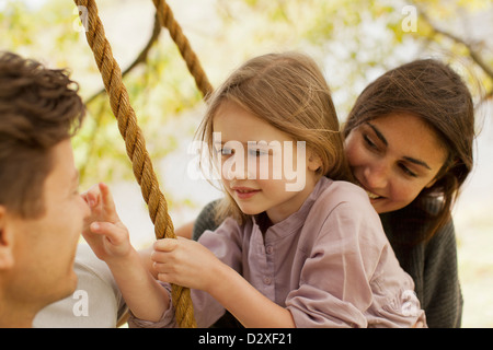Close up of family on swing - Stock Photo