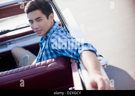 Man sitting in convertible - Stock Photo