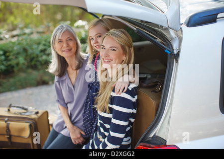 Three generations of women sitting in car - Stock Photo