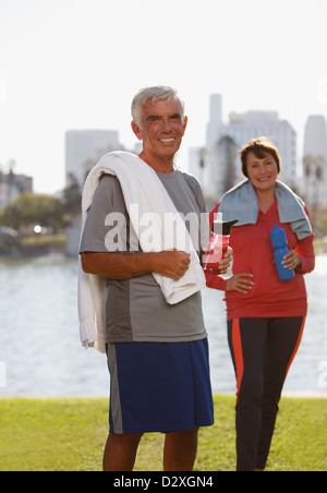 Older couple drinking water after workout - Stock Photo