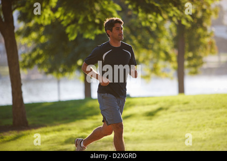 Man jogging in park - Stock Photo